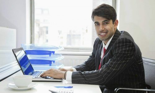 portrait-of-an-indian-businessman-in-office-business-man